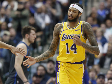 Los Angeles Lakers forward Brandon Ingram (14) is congratulated after scoring during the the second half of an NBA basketball game against the Dallas Mavericks in Dallas, Monday, Jan. 7, 2019. (AP Photo/LM Otero)